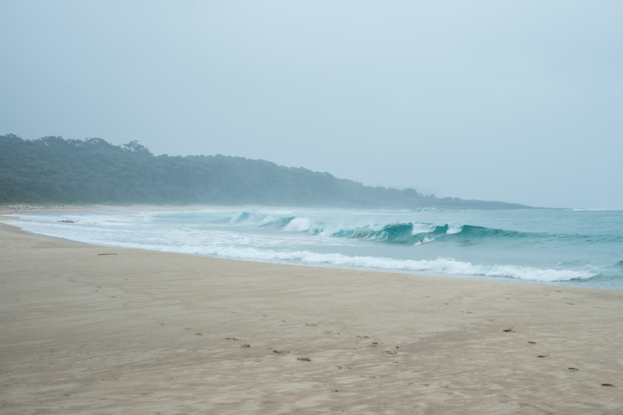 Bodysurfing the shorey in the rain, just before I dislocated my shoulder.