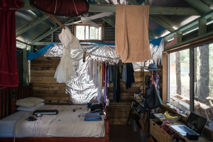 The inside of Spencer and Tamara's shack. The wall is being put together with recycled wood from palettes.