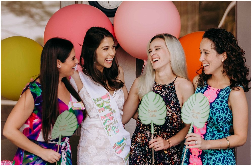 Lilly Pulitzer Bridal Shower Bride laughing with bridemaids and props