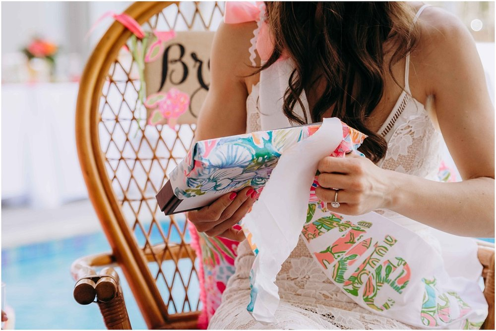 Lilly Pulitzer bride to be opening gifts