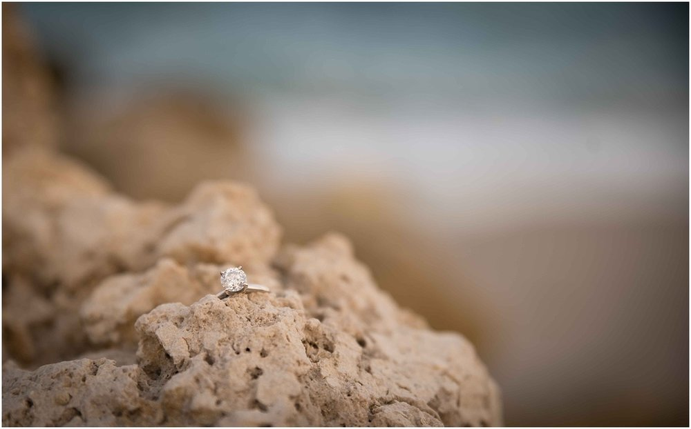engagement ring on the beach