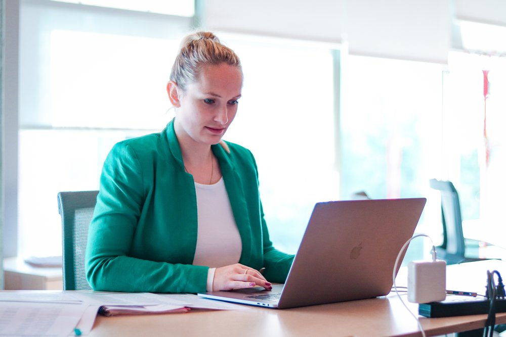a-young-professional-woman-working-in-a-modern-office-on-a-laptop-computer_t20_Ky79RE.jpg
