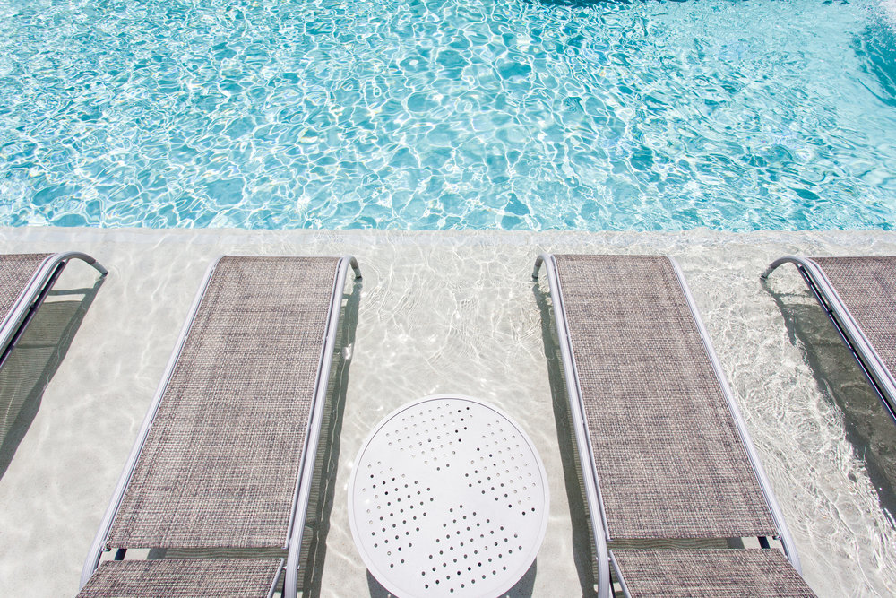 Pool with in-pool chaise loungers