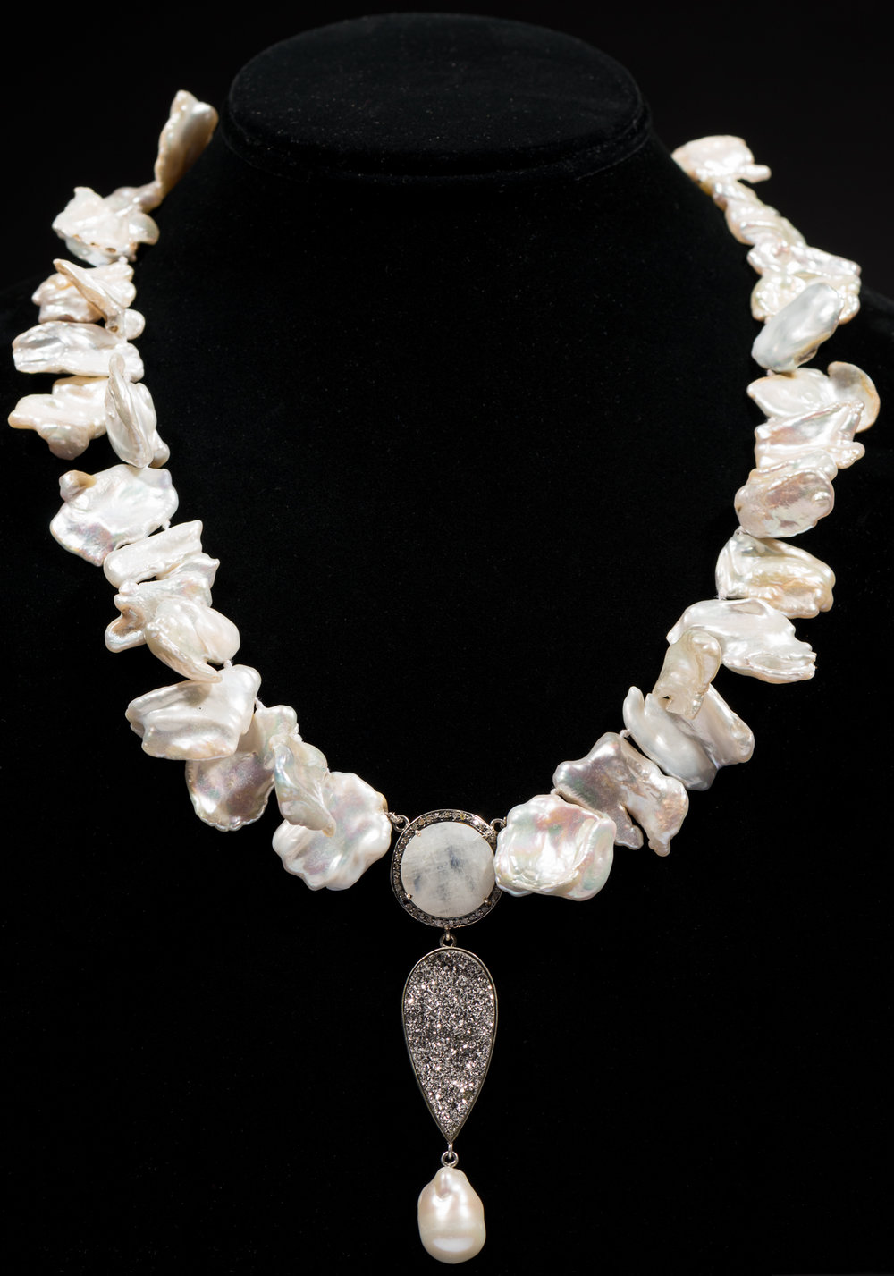 Freshwater pearls with pave diamonds surrounding moonstone, druzy encased in sterling silver and baroque pearl drop