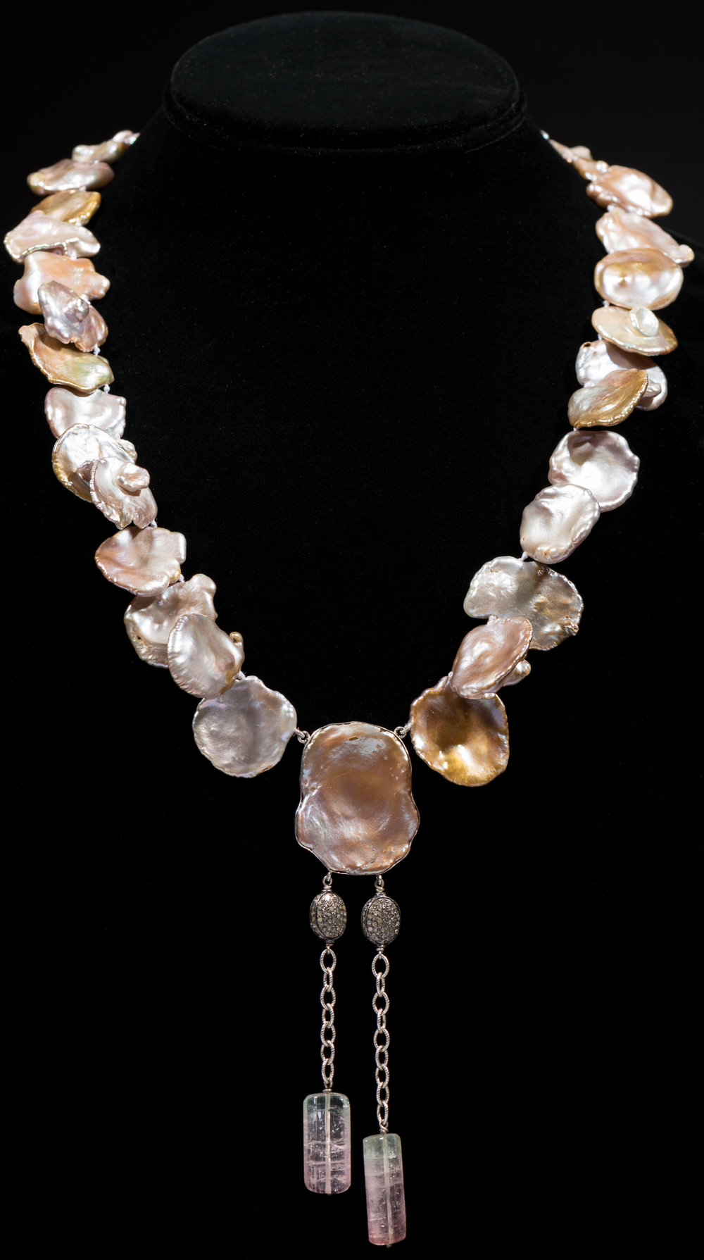 Cornflake freshwater pearls with center pearl encased in sterling silver with pave diamond and tourmaline drop.