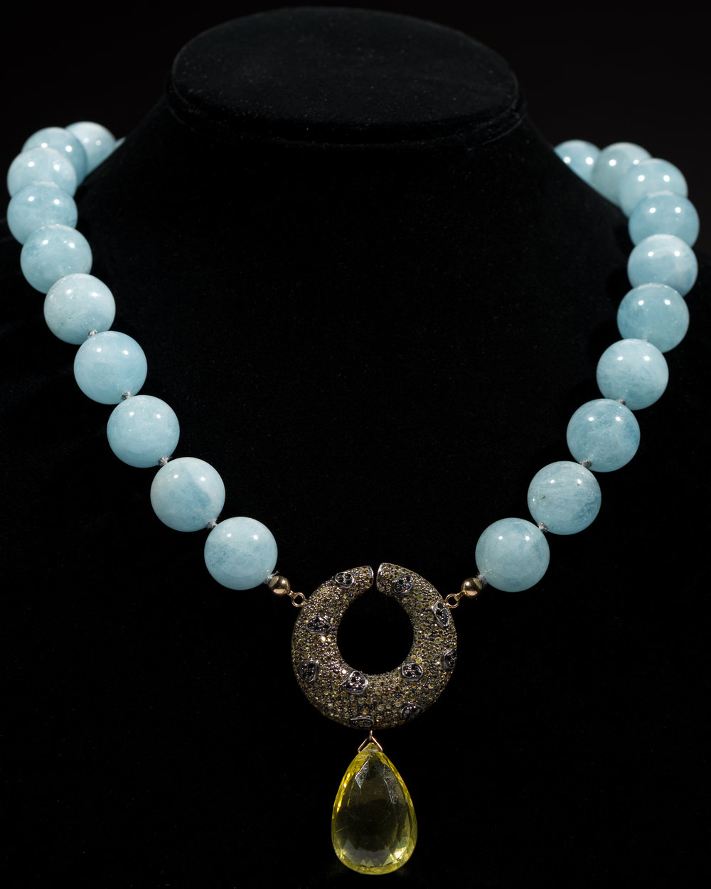 Turquoise colored round stones  with pave diamond and yellow topaz drop