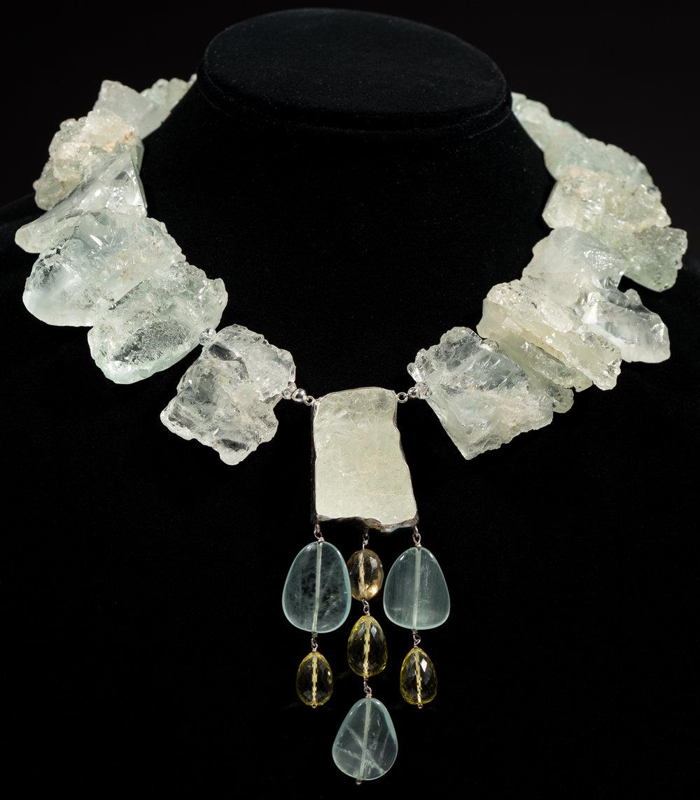 Rough cut aquamarine with drop of rough cut aquamarine encased in sterling silver and aquamarine and lemon quartz