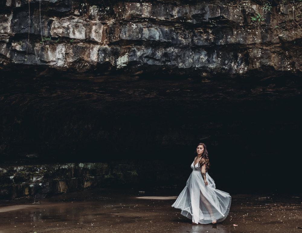 girl dancing in cave