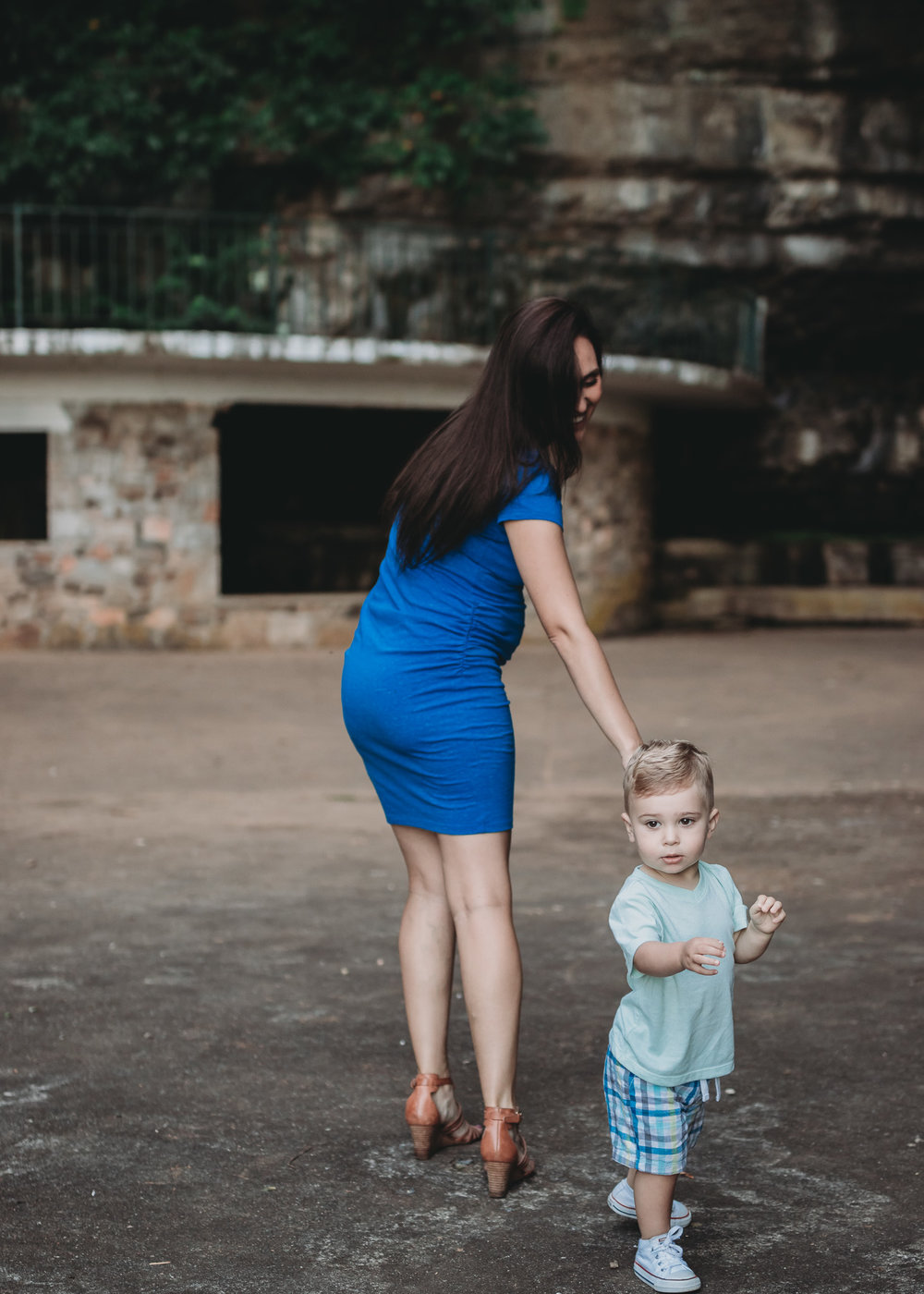 mom and son walking