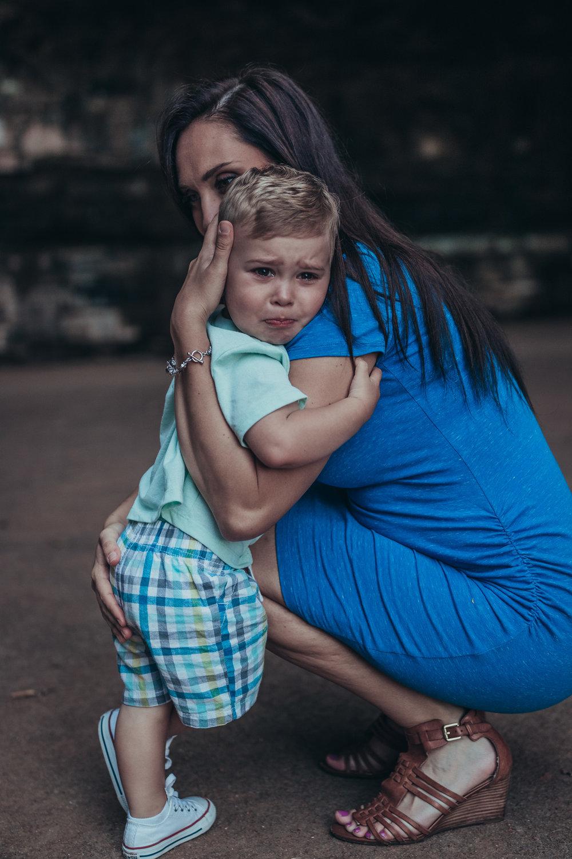 mom comforting sad toddler