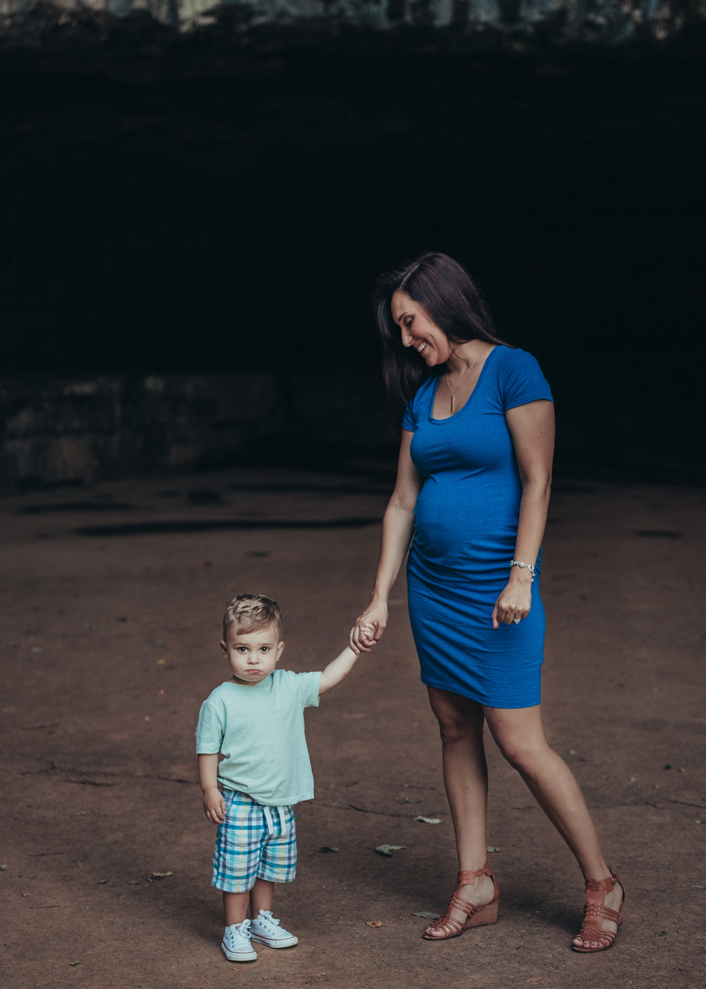 pregnant mom and son posing