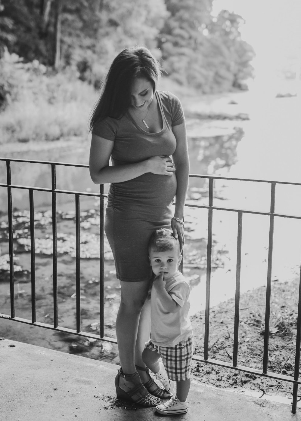 pregnant mom and toddler by water