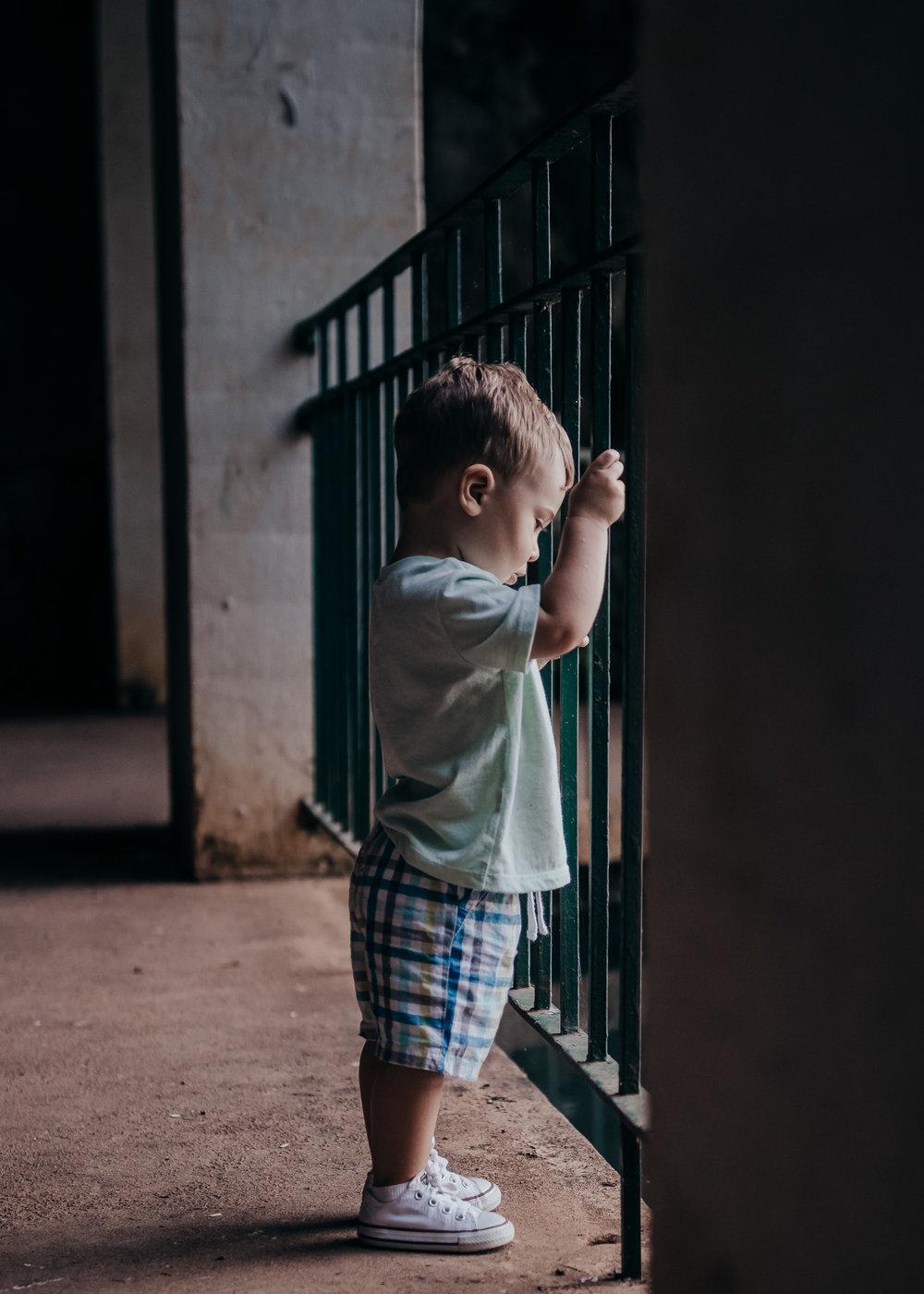 toddler boy looking at water