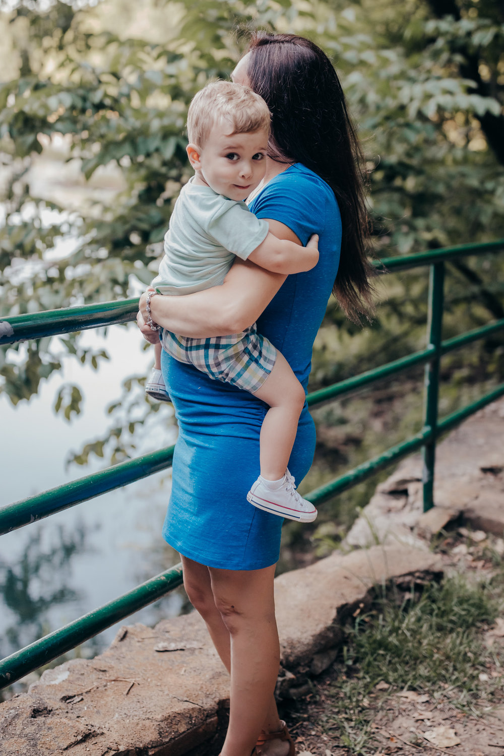 toddler son being held by mom