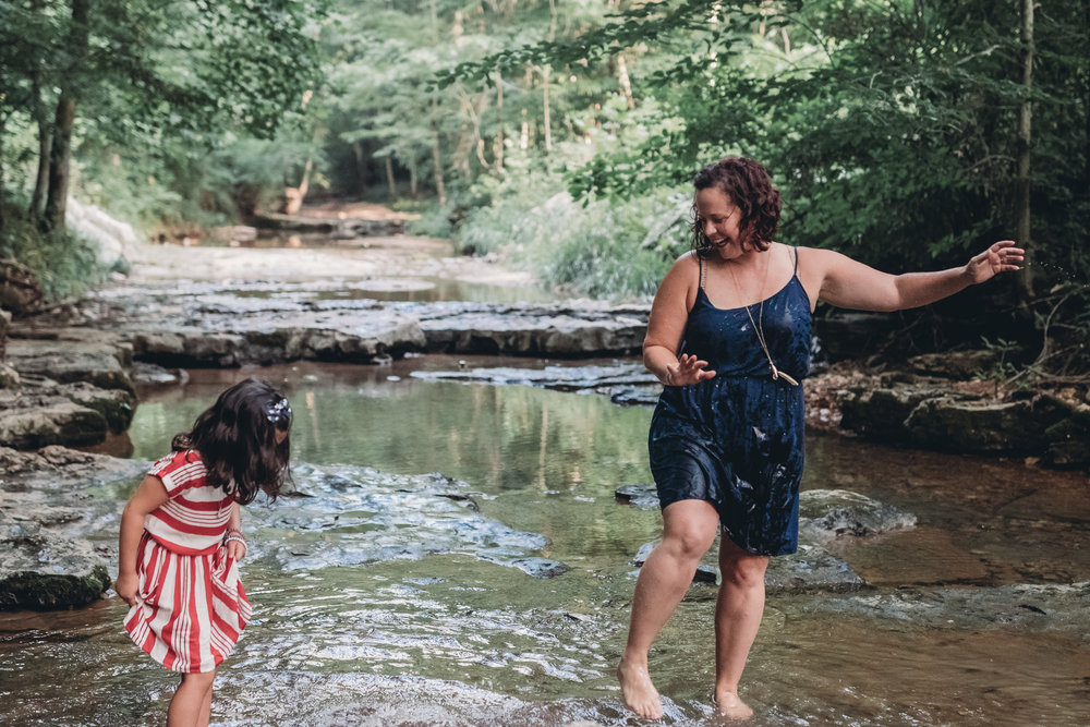 mom and daughter playing in the water
