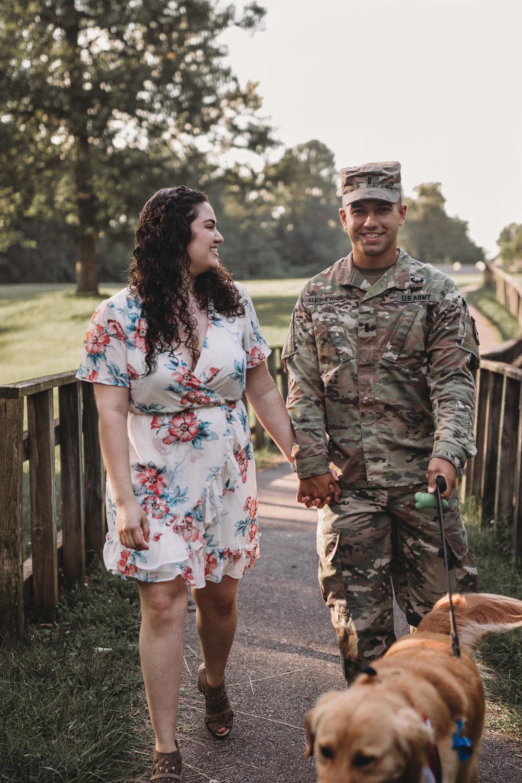 man in uniform walking dog with wife