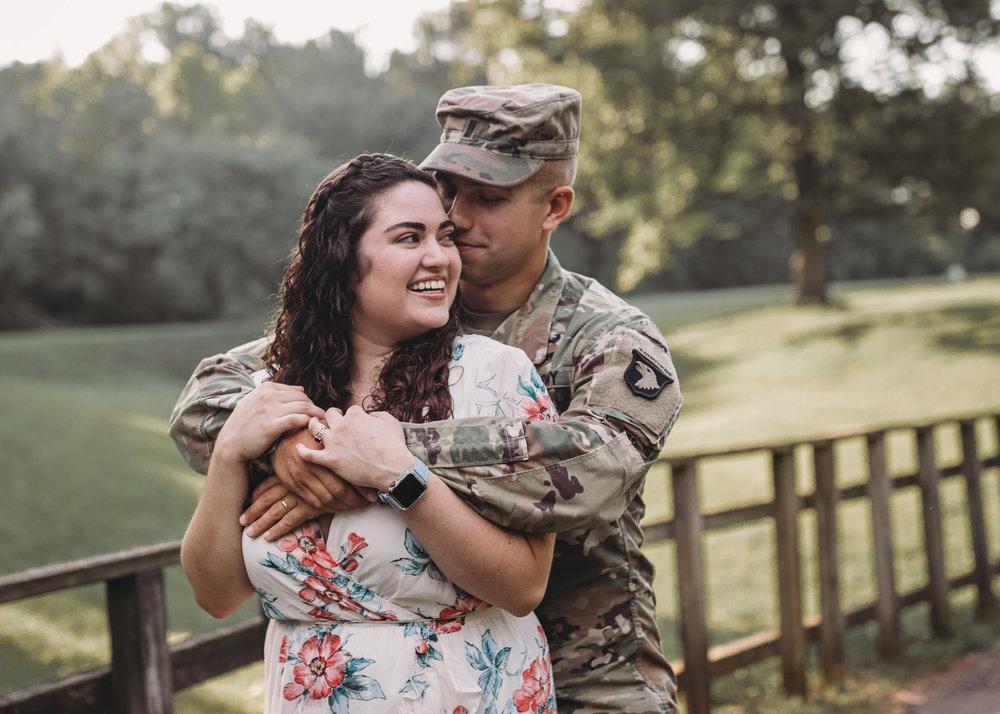 man in uniform hugging girl