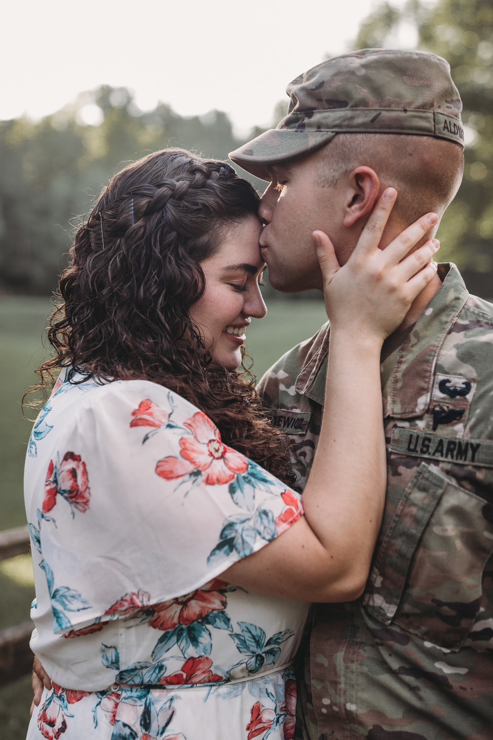 man in uniform kissing wife's forehead