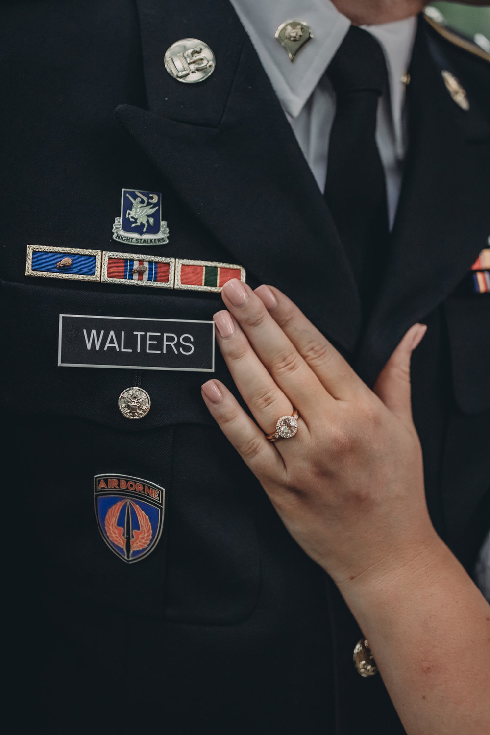 engagement ring shot on military uniform