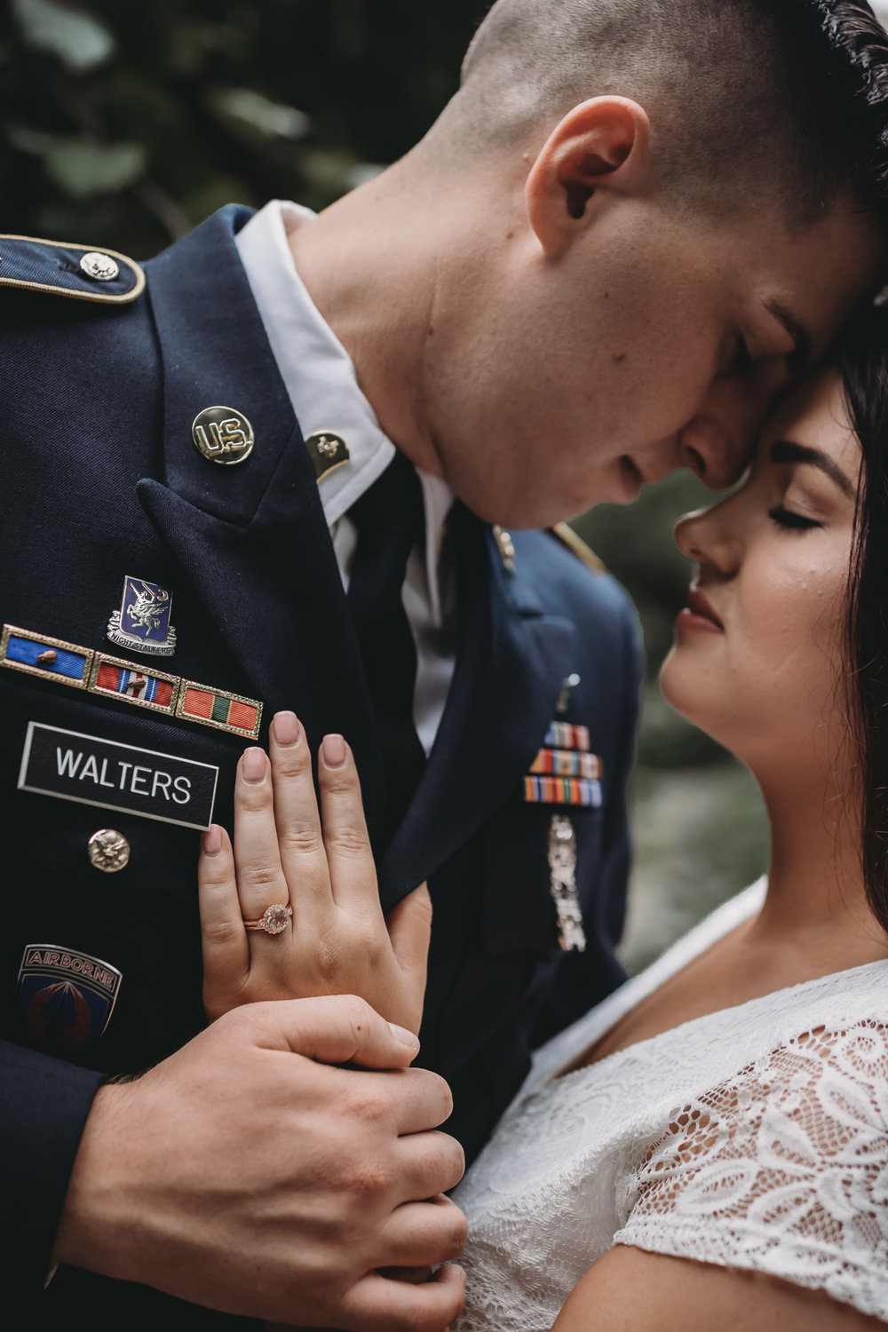 ring shot of engagement ring on military uniform