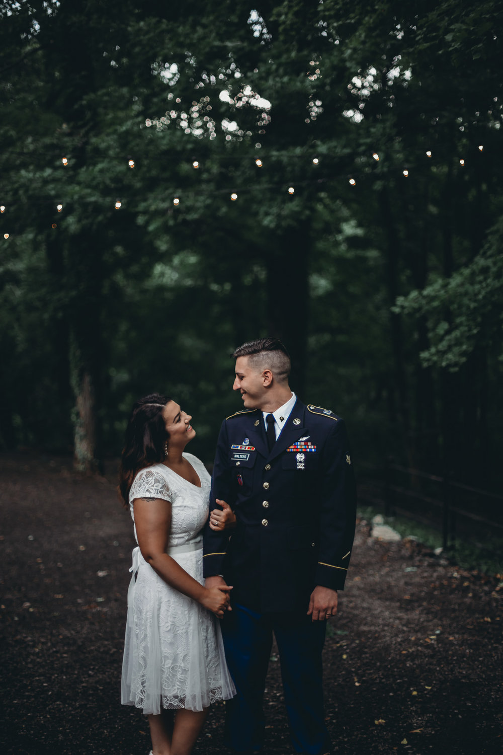 bride and groom in army dress uniform