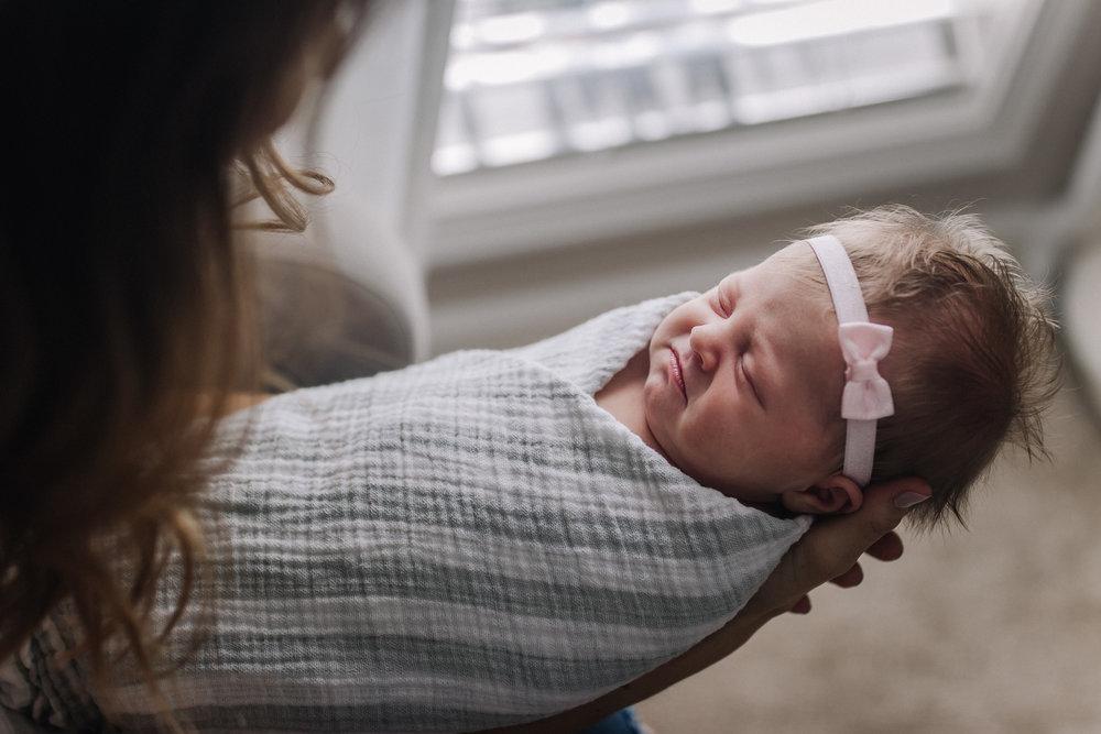 newborn baby girl in nursery