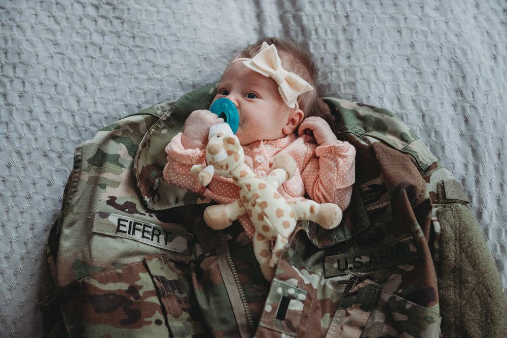 newborn baby and army uniform