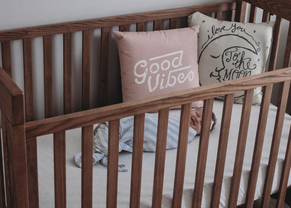 newborn in crib