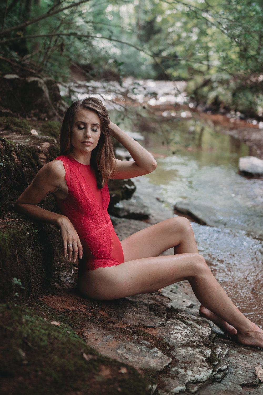 outdoor boudoir pose in water