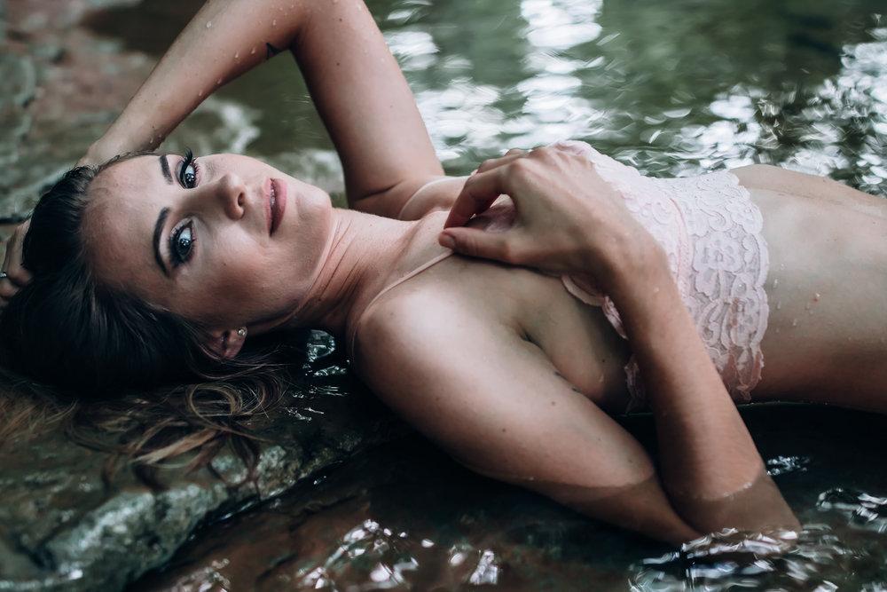 laying in water boudoir pose