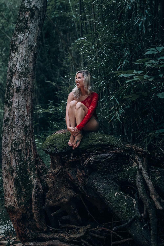 outdoor boudoir girl model sitting in tree