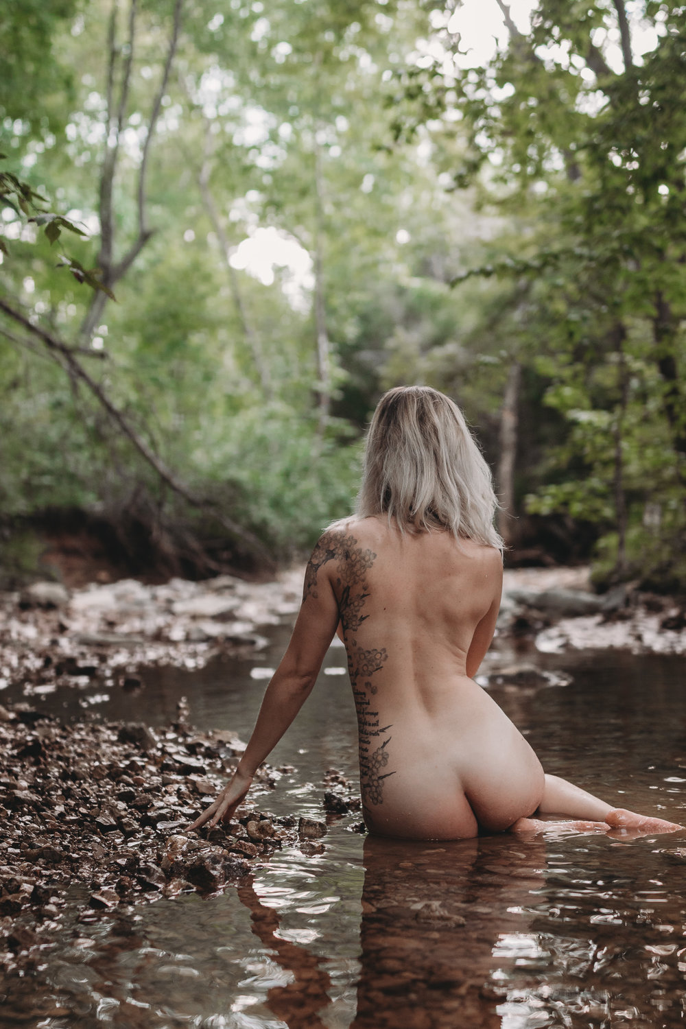 girl sitting naked in water