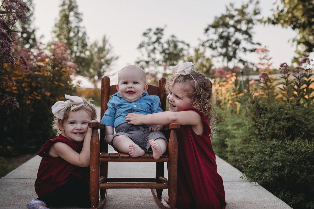 siblings in flower field