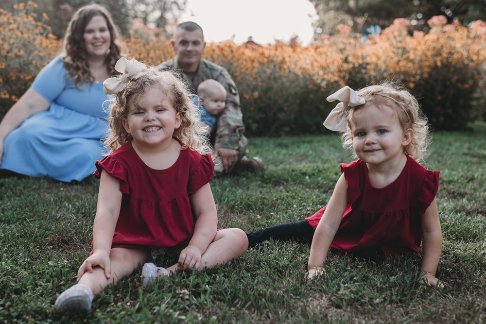 family of five in sunset flowers