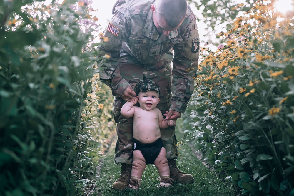 baby with dad in army uniform