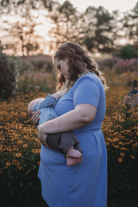 breastfeeding mom at sunset