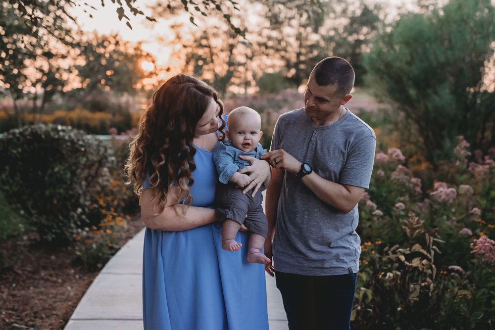 family with baby in sunset