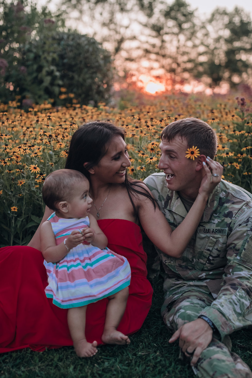being silly with army dad and flowers