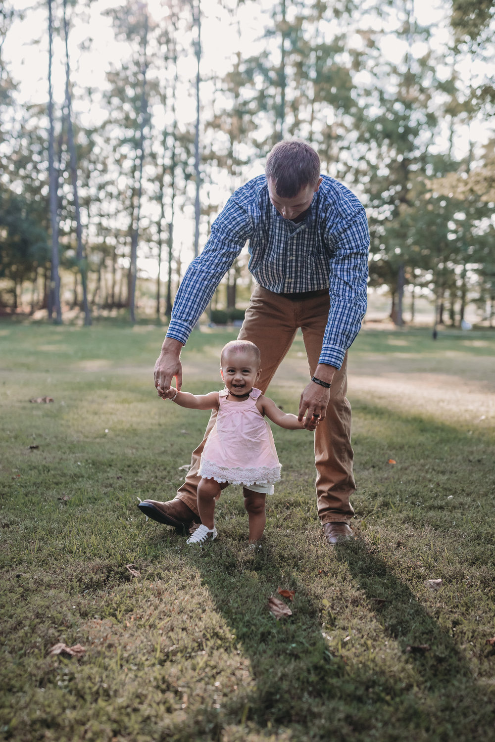 dad and daughter walking