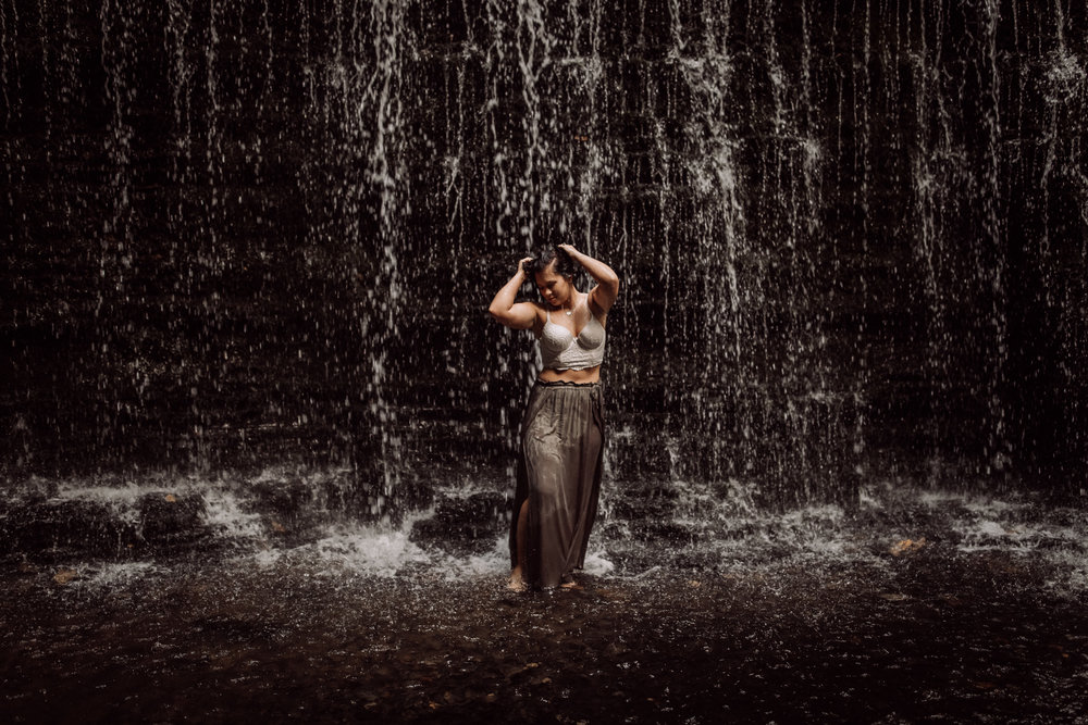standing in waterfall boudoir pose