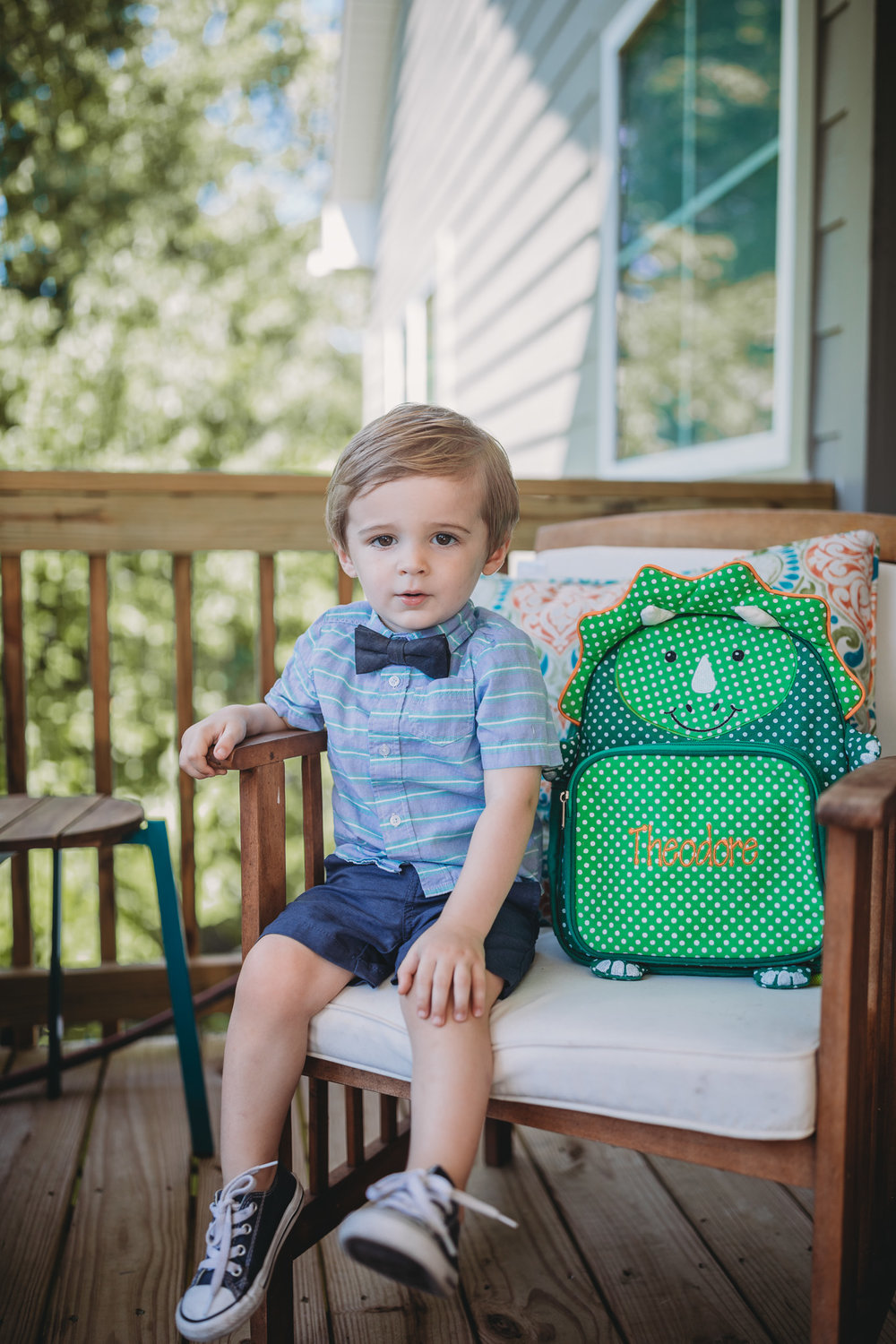 toddler sitting with backpack