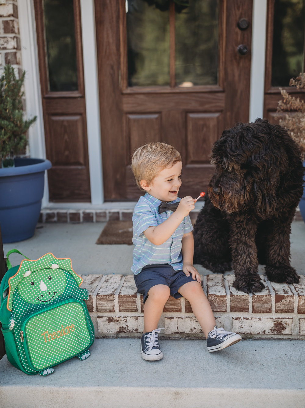 child and goldendoodle starting school