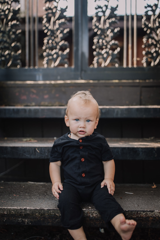 baby sitting on step