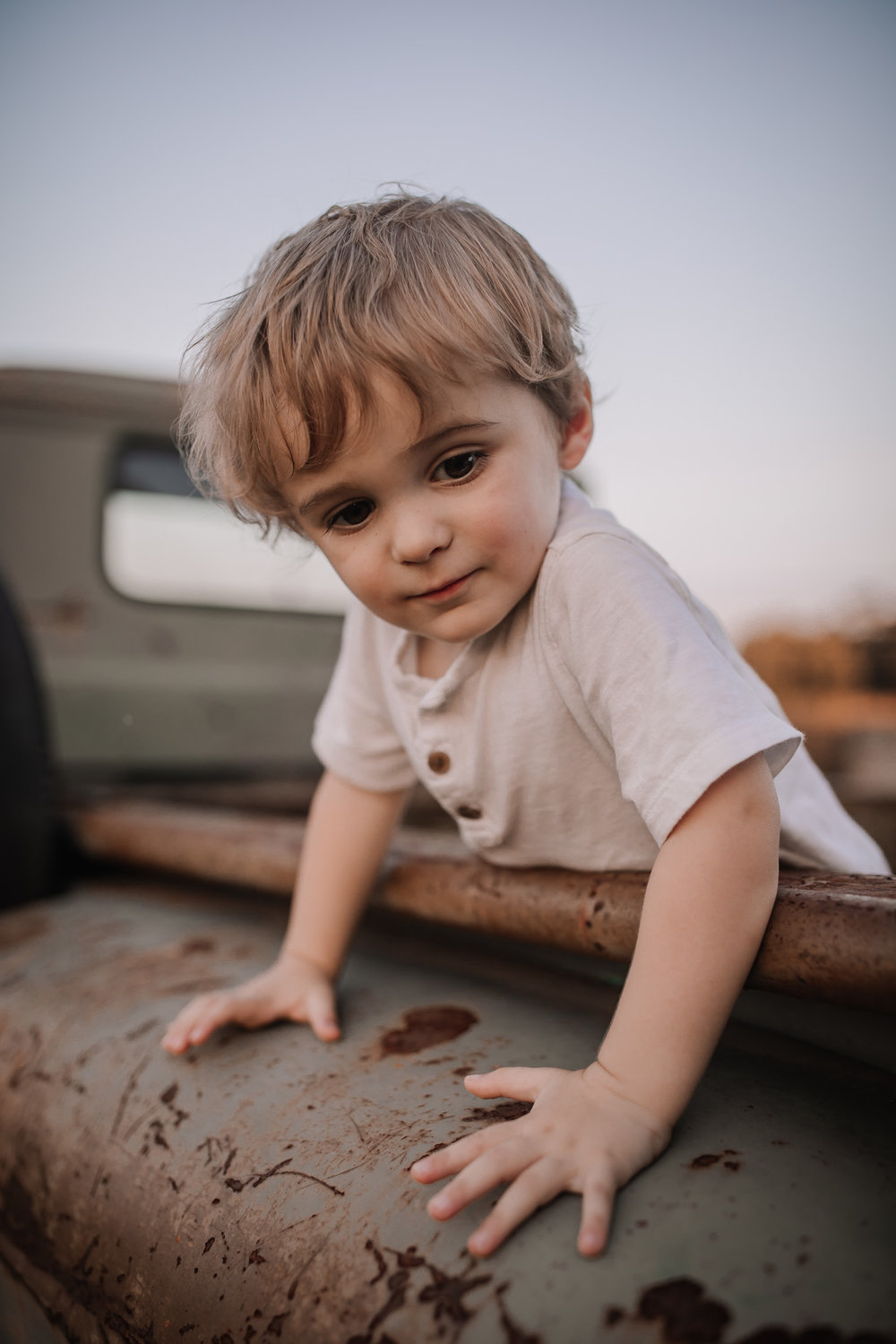 toddler in vintage truck bed