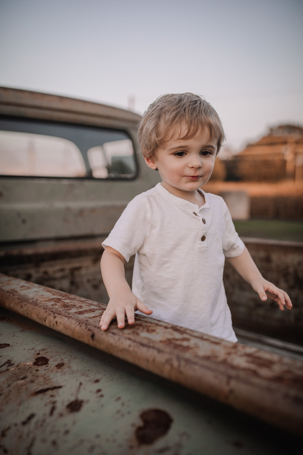 toddler in vintage truck