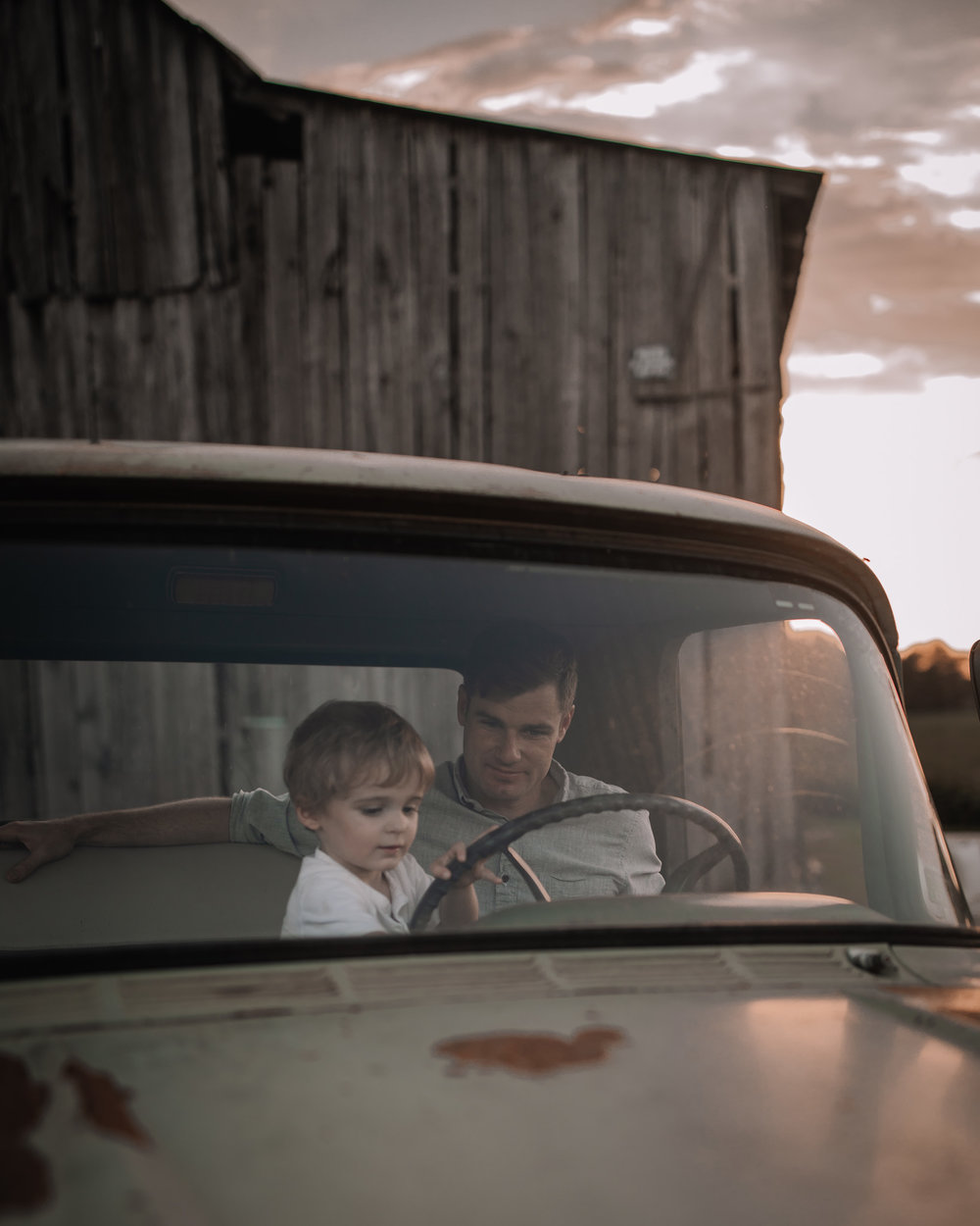 father and toddler in vintage truck