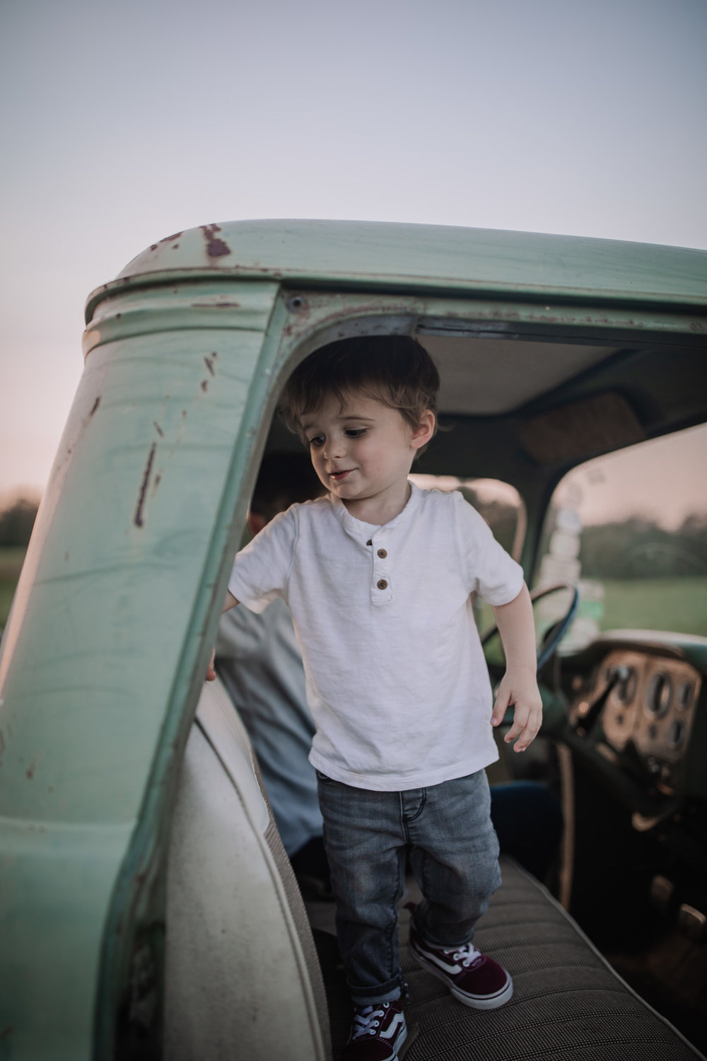 toddler boy in vintage truck