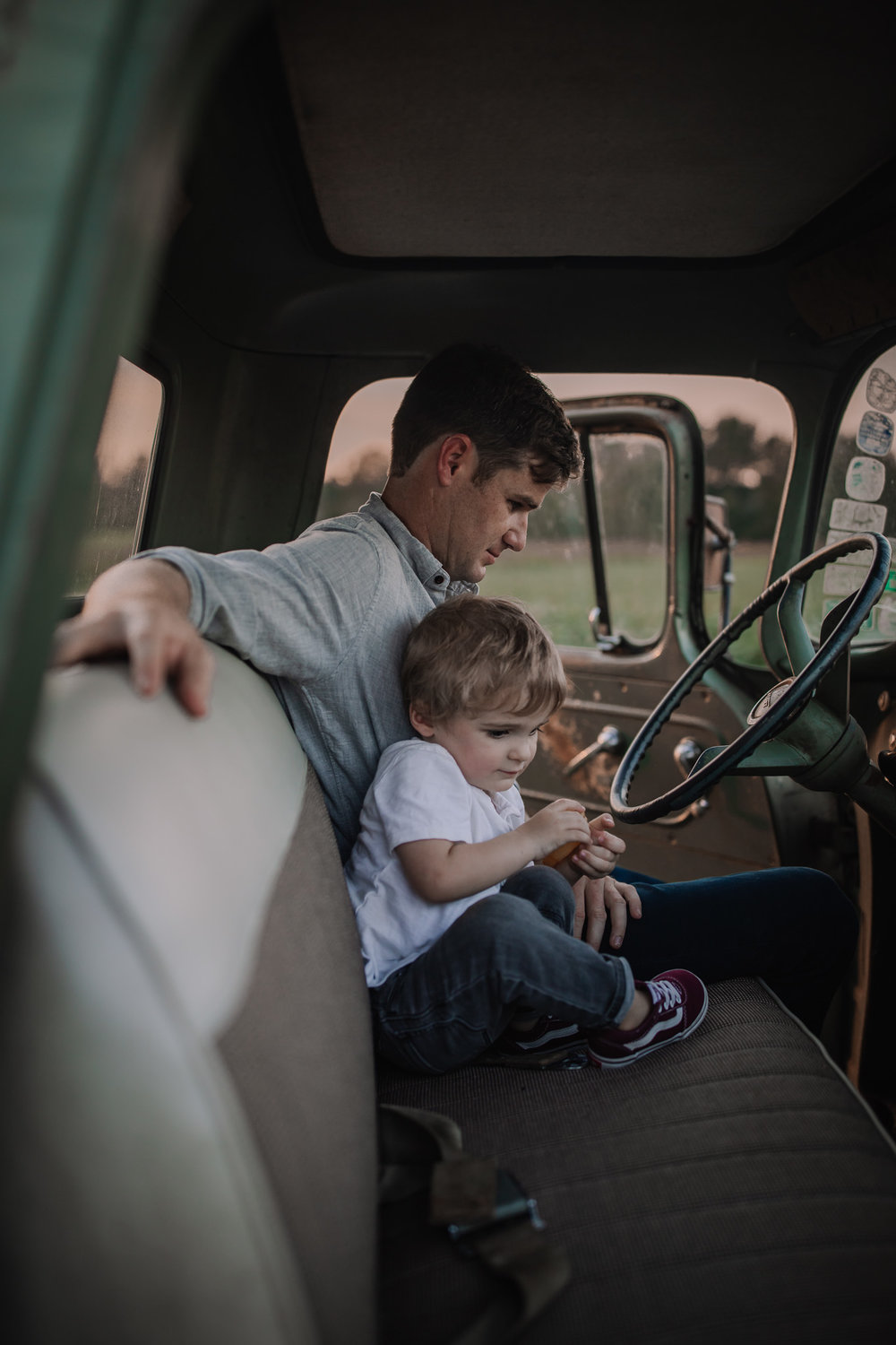 father and son in vintage truck