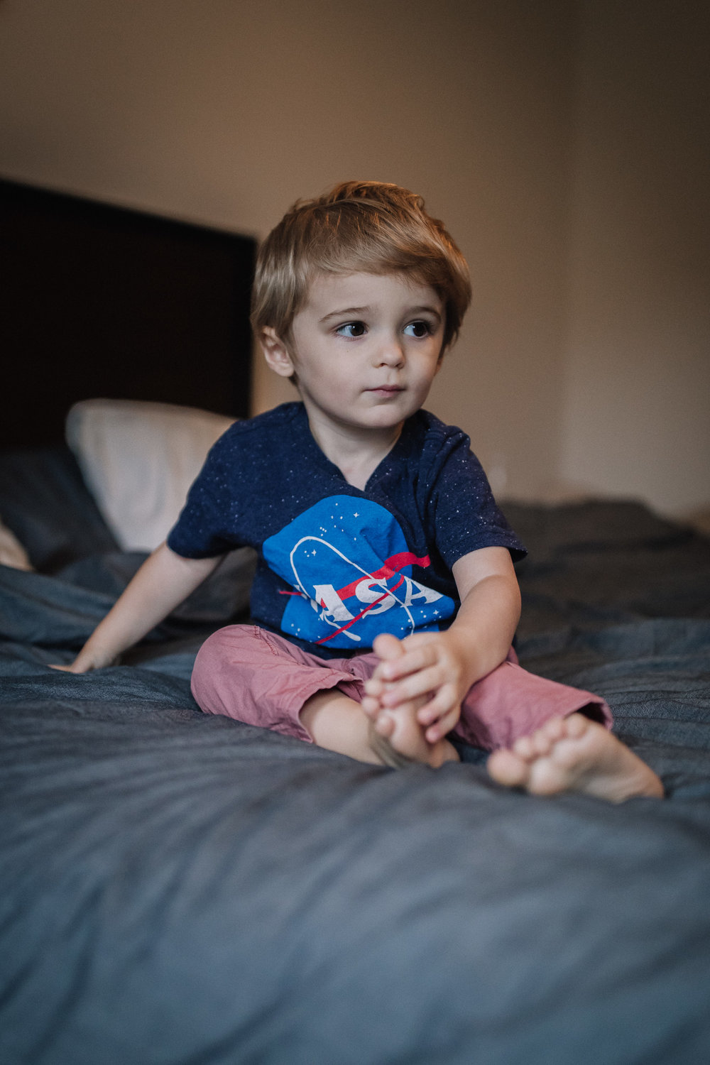 little boy on bed