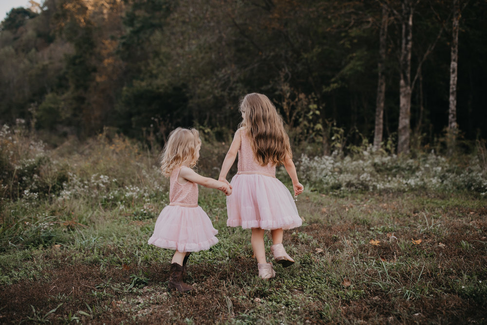little girls dancing together